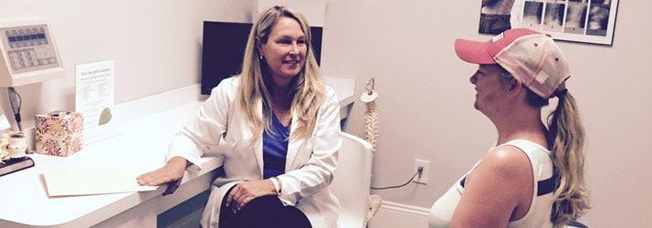 Chiropractor St Clair MI Elizabeth Brieden talking to patient